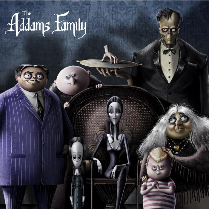 A portrait of a spooky family sitting in front of a dark grey wall. There is a white logo that says, The Addams Family.
