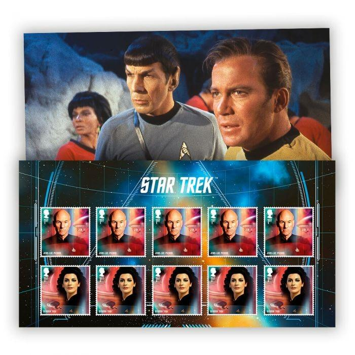 Two rows of stamps displaying characters from the Star Trek show. Behind the stamps is an image of three show characters looking off into the distance.