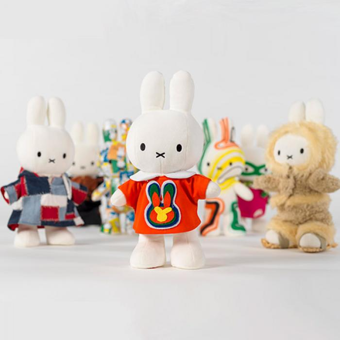 A bunch of white bunny characters, wearing colourful jackets displayed on a white background.