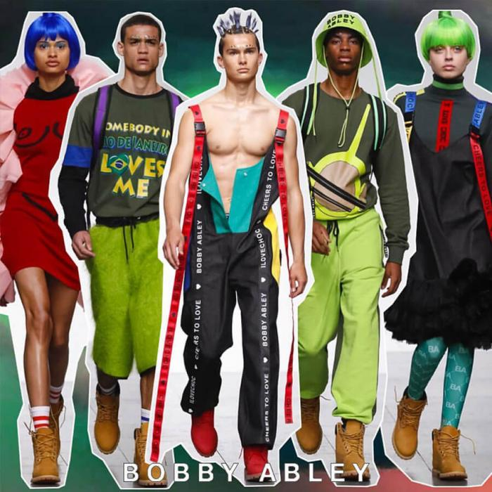 Five male and female models wearing colourful and unique outfits.