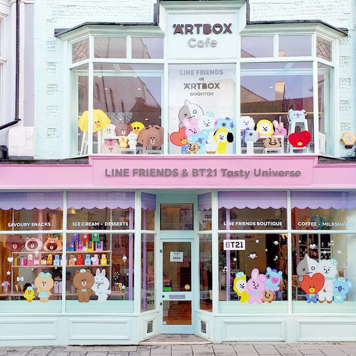 A bright and colourful storefront with cartoon character in the window display.